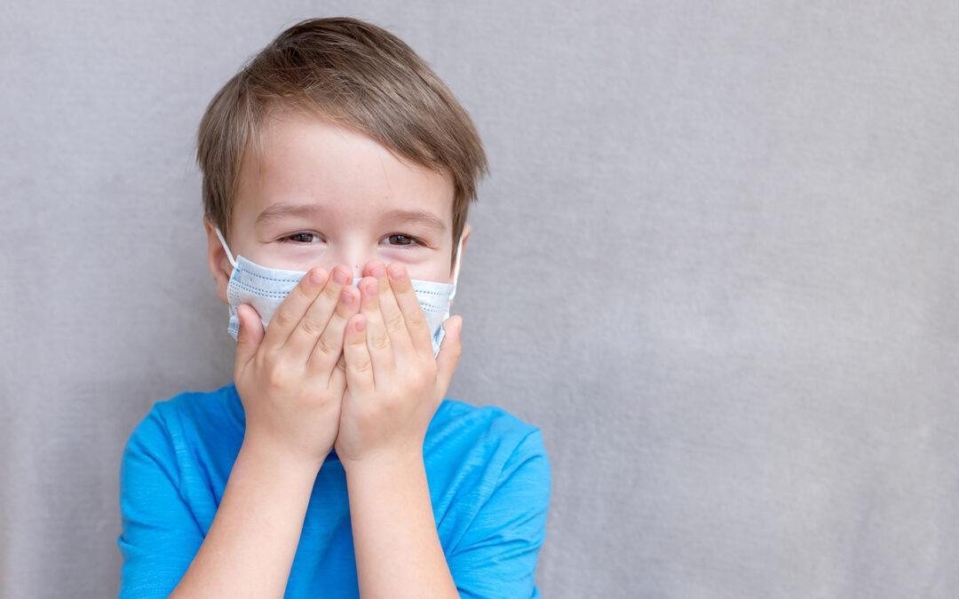 Toddler wearing a mask, flu season